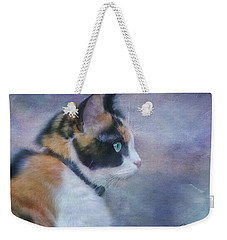 Weekender Tote Bag featuring the digital art The Calico Staredown  by Colleen Taylor