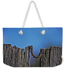 Weekender Tote Bag featuring the photograph The Caterpillar by Cendrine Marrouat
