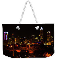 Weekender Tote Bag featuring the digital art The City Of Charlotte Nc At Night by Chris Flees
