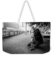 Weekender Tote Bag featuring the photograph The Cleaner Of Leaves by John Williams