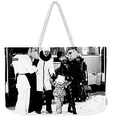 Weekender Tote Bag featuring the photograph The Collector Of Smiles by John Williams