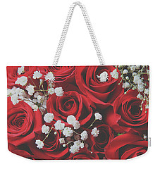Weekender Tote Bag featuring the photograph The Color Of Love by Laurie Search