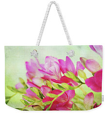 Weekender Tote Bag featuring the photograph Colour Full Freesia by Connie Handscomb