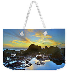 Weekender Tote Bag featuring the photograph The Colours Amongst Sea, Sky And Stone by Tara Turner