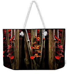 Weekender Tote Bag featuring the photograph The Crimson Forest by Jessica Jenney