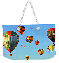 Weekender Tote Bag featuring the photograph The Crowded Skies by AJ Schibig