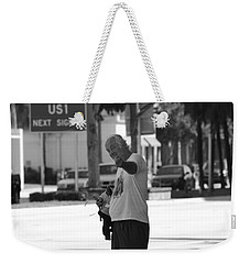 Weekender Tote Bag featuring the photograph The Devil Man by Rob Hans