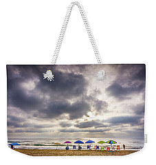 Weekender Tote Bag featuring the photograph The Diehard Beach Lovers by Gary Gillette