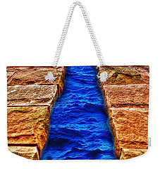 Weekender Tote Bag featuring the photograph The Divide by Paul Wear