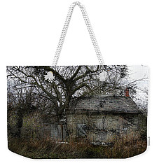 Weekender Tote Bag featuring the photograph The Earth Reclaims by Jim Vance