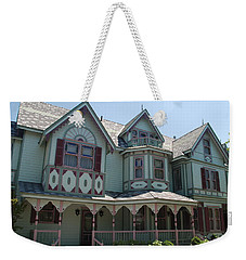 Weekender Tote Bag featuring the photograph The Empress by Richard Bryce and Family