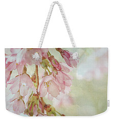 Weekender Tote Bag featuring the photograph The Essence Of Springtime  by Connie Handscomb