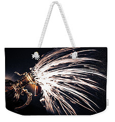 Weekender Tote Bag featuring the photograph The Exploding Growler by David Sutton