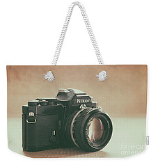 Weekender Tote Bag featuring the photograph The Fabulous Nikon by Ana V Ramirez