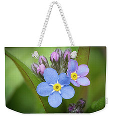 Weekender Tote Bag featuring the photograph The First Blossom Of The Forget Me Not by William Lee