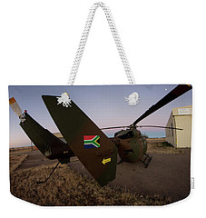 Weekender Tote Bag featuring the photograph The Flag by Paul Job