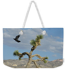 Weekender Tote Bag featuring the photograph The Flight Of Raven. Lucerne Valley. by Ausra Huntington nee Paulauskaite