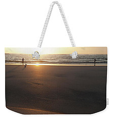 Weekender Tote Bag featuring the photograph The Full Sun by Eric Christopher Jackson