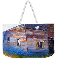 Weekender Tote Bag featuring the photograph The Garage by Susan Kinney