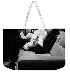 Weekender Tote Bag featuring the photograph The Girl The Polar Bear And The Phone by John Williams
