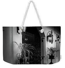 Weekender Tote Bag featuring the photograph The Glow Of Gas In Black And White by Greg Mimbs