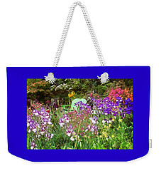 Weekender Tote Bag featuring the photograph Hiding In The Garden by Thom Zehrfeld