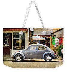 Weekender Tote Bag featuring the photograph The Grey Beetle by Craig J Satterlee