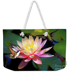 Weekender Tote Bag featuring the photograph The Grutas Water Lillie With Hummingbirds by John Kolenberg
