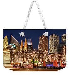 Weekender Tote Bag featuring the photograph The Hague Skyline From The Plein by Barry O Carroll