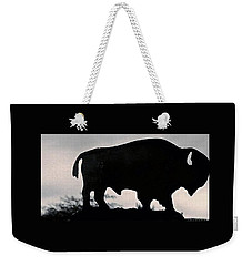 Weekender Tote Bag featuring the photograph The Iron Buffalo Push by John Glass
