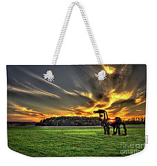 Weekender Tote Bag featuring the photograph The Iron Horse Sunset by Reid Callaway