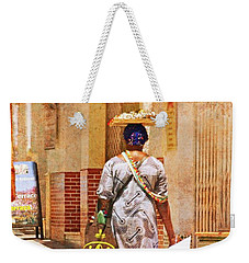Weekender Tote Bag featuring the photograph The Jewelry Seller - Malaga Spain by Mary Machare