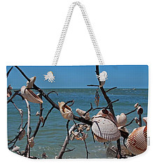 Weekender Tote Bag featuring the photograph The Kindness by Michiale Schneider