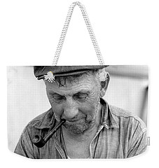 Weekender Tote Bag featuring the photograph The Pipe Smoker by John Stephens