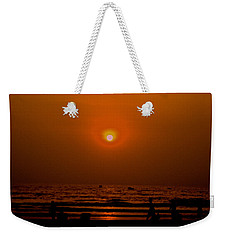 Weekender Tote Bag featuring the photograph The Last Rays by Sher Nasser
