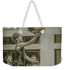 Weekender Tote Bag featuring the photograph The Layup by Ronald Santini