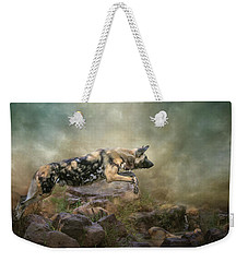 Weekender Tote Bag featuring the digital art The Leap by Nicole Wilde