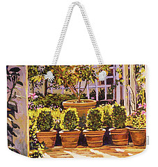 The Lemon Tree Courtyard Weekender Tote Bag