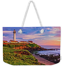 Weekender Tote Bag featuring the photograph The Light Of Sunset by John Hight