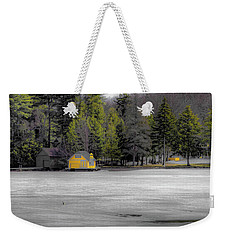 Weekender Tote Bag featuring the photograph The Lighthouse On Frozen Pond by David Patterson