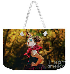 Weekender Tote Bag featuring the photograph The Little Queen Of Hearts Alice In Wonderland by Dimitar Hristov