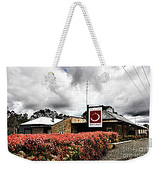Weekender Tote Bag featuring the photograph The Little Red Grape Winery   by Douglas Barnard