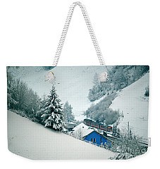 Weekender Tote Bag featuring the photograph The Little Red Train - Winter In Switzerland  by Susanne Van Hulst