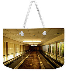 Weekender Tote Bag featuring the photograph The Long Hall by Eric Christopher Jackson