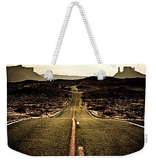 Weekender Tote Bag featuring the photograph The Long Road by Marilyn Hunt