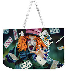 Weekender Tote Bag featuring the photograph The Mad Hatter Alice In Wonderland by Dimitar Hristov