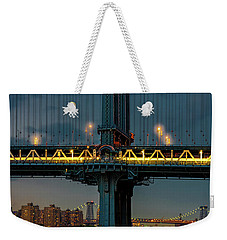 Weekender Tote Bag featuring the photograph The Manhattan Bridge During Blue Hour by Chris Lord