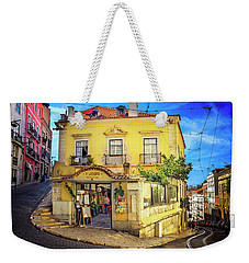 Weekender Tote Bag featuring the photograph The Many Colors Of Lisbon Old Town  by Carol Japp