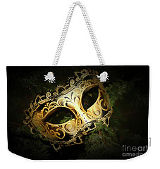 Weekender Tote Bag featuring the photograph The Mask by Darren Fisher