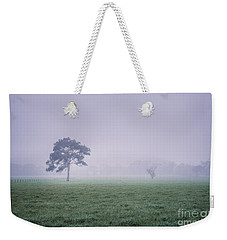 Weekender Tote Bag featuring the photograph The Mist Settles by Ray Warren